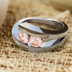 Talinn diamond engagement ring with two pink created lab-diamonds and white ethical gold. From the #DeVindt contemporary collection.