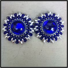 Earrings with Superduo beads and soft touch center pieces.