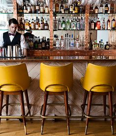 We'd frequent this bar just to sit in these stunning stools.