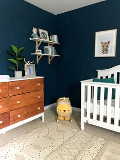 Nursery reveal for a baby boy. Nuetral vibes, safari-tribal nursery theme with dark blue walls. Navy blue, white, and wood tones are used. Dark Nursery, Navy Blue Nursery, Navy Blue Walls, Baby Nursery Neutral, Safari Nursery, Nursery Boy, Tribal Nursery, Blue Nursery Ideas, Baby Room Design