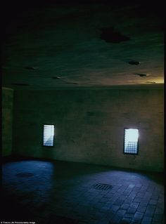 Shafts of light can be seen in one of the gas chambers at Dachau concentration camp taken five years after the last survivor left the camp. That room...if walls could cry...