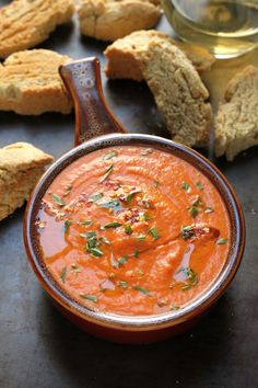Creamy Tomato and Tarragon Soup with Parmesan Black Pepper Biscotti - this healthy, delicious soup is made creamy with Greek yogurt and comes together in less than 30 minutes!