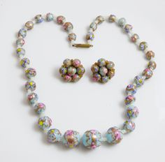 """Italian Light Blue Wedding Cake Bead Necklace and Clip Earrings. Murano glass beads with vintage white glass seed bead spacers. The necklace measures 17 1/2"""" in length with a brass fishhook clasp. The"""