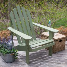 Enjoy a respite from the rest of the world with this Sage Green Wood Adirondack Chair for Outdoor Patio Garden Deck. Made with eco-friendly Acacia wood, this chair features a beautiful sage green pain