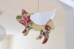 Whimsical and similar in concept to C's cardstock elephant mobile. Maybe I'll make one for a future nursery/bedroom...Pointless Pretty Things: DIY Flying Pigs