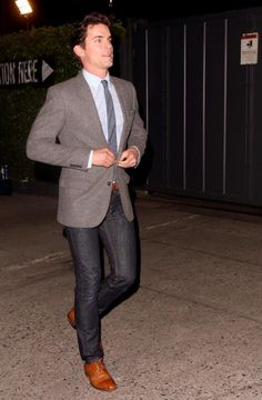 Matt Bomer from White Collar adds a casual touch to his jacket and tie with dark denim.