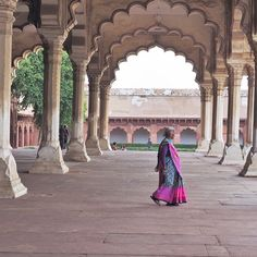 A woman in a colourful saree at Agra Fort, India. Photo by Andrea Rees.