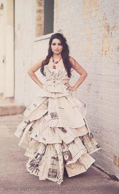 Dress made out of newspaper... so unique!  Love her project idea of timeline  dresses in newspaper!