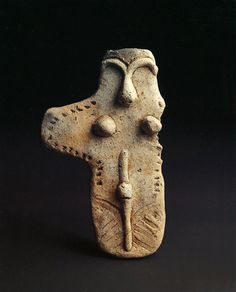 Board-formed clay figure, Dogu. B.C.3500-B.C.2500. Jomon Period. Tohoku Region.