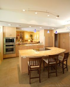Modern Light Wood Kitchen Cabinets kitchen peninsula ideas | pictures of kitchens - modern - light
