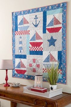 Nautical Quilt Wall Hanging: http://www.completely-coastal.com/2015/10/coastal-beach-nautical-quilts-wall-hangings.html
