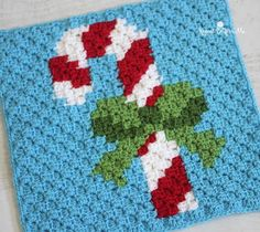 Candy Cane Pixel Square by Repeat Crafter Me. Crochet this fun pixel square on its own or as part of a Christmas Afghan! Make it with Vanna's Choice in red, white, green, and blue and a size F crochet hook! Christmas Crochet Blanket, Christmas Afghan, Christmas Crochet Patterns, Holiday Crochet, Crochet Square Patterns, Afghan Crochet Patterns, Crochet Squares, Crochet Granny, Crochet Afghans