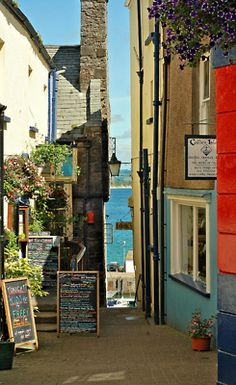~ looking down an alley to the sea ~  Caldey Island Shop to the right ~ Tenby ~ Pembrokeshire ~ Wales ~