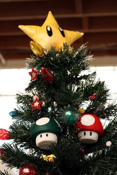 Nintendo Super Mario Bros. Starman Christmas tree topper. For more great geek fashions, home decor, and holidays visit http://pinterest.com/SuburbanFandom/geek-home-and-holiday/
