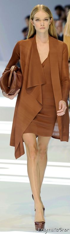 ~ From the runway: this is Look 23.  It doesn't matter that this outfit is from 2010...a scant 5 years ago.  The great lines and flow of the V-neck short dress worn underneath a matching lightweight caramel coat with cascading collar.  Love the color palette; just add some great earrings, a stunning necklace & you're good to go! ~