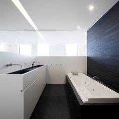 Black and white bathroom inside the RRR penthouse on the Belgian coast _