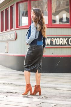 Add some contrast to your outfit by pairing your patchwork jacket with a leather midi skirt and some suede boots. (Source: Lace And Combat Boots)
