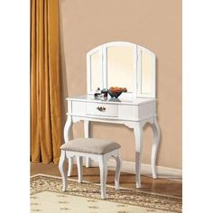 Maren white finish wood bedroom makeup vanity with tri-fold mirror and stool. This set includes the vanity table, tri fold mirror and stool. Vanity measures x x H, Stool measures x x H. Mirror measures x H. Wood Makeup Vanity, Bedroom Makeup Vanity, Wooden Vanity, Vanity Desk, Makeup Stool, Makeup Vanities, White Vanity Set, Vanity Set With Mirror, White Mirror