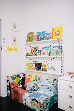 Amelie's cosy corner of the world - foam cut by local supplier, Ikea fabric covers.  Ikea shelves for books.  (melb)  via Babyology