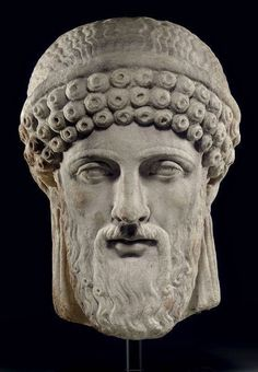 A Greek marble archaistic head of Dionysos,2nd c.AD.