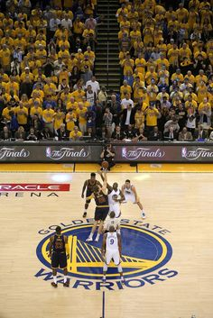 Cavalier's Timofey Mozgov, (20) and Warriors' Draymond Green, (23) tip off to begin the game, as the Golden State Warriors take on the Cleveland Cavaliers in game 5 of the NBA finals at Oracle Arena in Oakland, , Calif., as seen on Sun. June 14, 2015. Photo: Michael Macor, The Chronicle