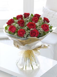 Red roses, hand tied. Love flowers. Heavenly Red Rose Hand-tied