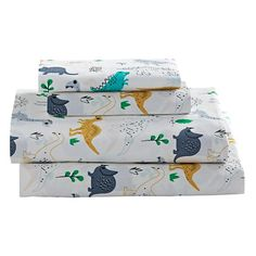 Shop Retro Reptile Dinosaur Sheet Set.  This exclusive dinosaur kids sheet set is covered with printed dinosaurs for your dino loving kiddo.  Shop for unique bedding for your boys' room.