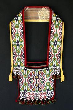 Winnebago Bandolier Bag  c. 1890  Classic loom beaded geometric motifs on blue trade cloth with yarn tassels  32 x 17 in.