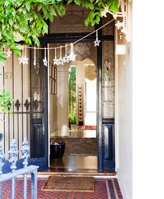 Love this entry way. This home seems to be very eclectic from Victorian entryway to the modern back rooms & pool area.