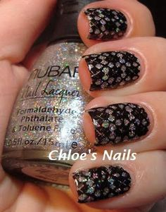 looks kinda like a lace mani but it's not!  super sparkle Nubar polish with a stamping in black polish over it.  so cool!