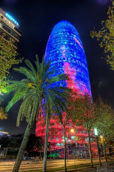The Torre Agbar, near Plaça de les Glòries Catalanes, Barcelona. This is a 38 story skyscraper. It was designed by French architect Jean Nouvel. It is named after its owners, the Agbar Group. The floors are taken up mainly by the corporate headquarters. Barcelona Architecture, Barcelona City, Barcelona Catalonia, Barcelona Travel, Amazing Architecture, Most Beautiful Cities, Beautiful Places To Visit, Beautiful Buildings, Gaudi