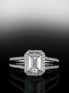 Bez Ambar emerald cut center diamond with pave frame and split shank mounting.  Available at Alson Jewelers.