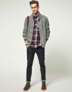 A grey knit cardigan and black jeans feel perfectly suited for weekend activities of all kinds. Channel your inner Ryan Gosling and rock a pair of brown suede boots to class up your look.  Shop this look for $196:  http://lookastic.com/men/looks/navy-longsleeve-shirt-grey-cardigan-black-jeans-brown-boots/5534  — Navy Plaid Longsleeve Shirt  — Grey Knit Cardigan  — Black Jeans  — Brown Suede Boots