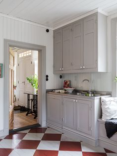 scandinavian farmhouse kitchen with grey cabinets + diamond pattern painted floor | interior design + decorating ideas