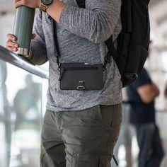 The Dango Pioneer Travel Wallet has space for 8 cards, a passport, a pen, and comes with the brand's Clasp tool. It has a shoulder strap for easy carry. Leather Wallet, Leather Bag, Wedding Ring For Him, Cool Gadgets To Buy, Thing 1, Mens Gear, Travel Items, Crossbody Shoulder Bag, Cool Things To Buy