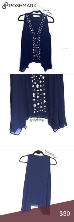 """TBags Womens Jeweled VNeck Asymmetrical Sleeveless SIZE: 0x/ 1x  DETAILS/STYLE : lounge / casual / asymmetrical / jeweled neckline / v neck / Sleeveless / navy blue / dark blue / diamonds /  BRAND: TBags Los Angeles  MATERIAL: 64% rayon 36% viscose  COLOR: blue  MEASUREMENTS:  Length :Approx 26"""" Underarm To Underarm : Approx 23"""" Bust : Approx between 40-44"""" Sleeve : Approx n/a CONDITION : Great Pre Loved Condition  COUNTRY OF MANUFACTURER : USA / LOS ANGELES  SMOKE FREE & PET FREE…"""