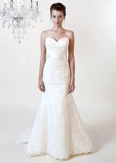 Victoria 9141 A lace gown with sweetheart neckline satin sash at the natural waistline.Available in Crystal White and Cream Pearl.