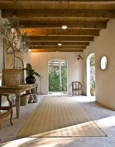 This loggia with wooden beams is amazing.