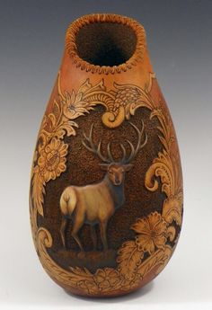 Judy Richie artist > this is made from a Gourd! Love the leather tooling artwork