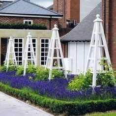 This is a photo taken by me at The Belfry Hotel near Birmingham in August 2014 and shows 4 Large Painted Obelisks painted White to a specific RAL code, tall and part of a group of 10 in total made by The Wooden garden Obelisk Company Potager Garden, Garden Arbor, Garden Trellis, Garden Beds, Garden Landscaping, Obelisk Trellis, Deco Floral, Garden Architecture, Garden Cottage