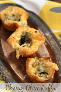 Cheesy Olive Puffs ~ Flaky crescents stuffed with cheese and olives!