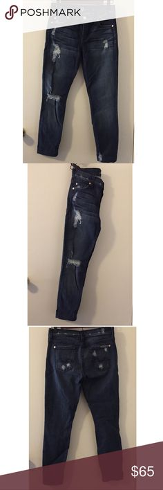 7 For All Mankind Jeans. 7 For All Mankind masters the lived-in look with this perfectly worn skinnies. With ripped knees, fraying and fading, this jeans fit just the way you like. 7 For All Mankind Jeans