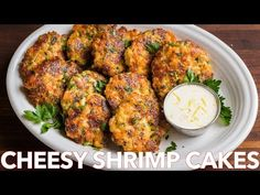 Cheesy Shrimp Cakes aka Shrimp Fritters with irresistible lemon aioli sauce. One of our favorite shrimp recipes! Biting into juicy shrimp, fritter style, is a real treat. The cheese creates an irresistible cheese pull inside and forms a golden crust on the outside.