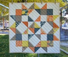 """Yesterday I finished up a new table topper for fall. Yay!       It measures 31"""" square. I used one charm pack  and a solid creamy white ..."""