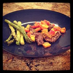 Dinner tonight was venison steak seared for 30 seconds each side with garlic, pepper, Himalayan salt and grass-fed butter followed by 20 minutes in the oven at 300 for 20 minutes.  It was topped with sautéed red, yellow, orange bell pepper, and onion in the same spices and served with a side of steamed asparagus.