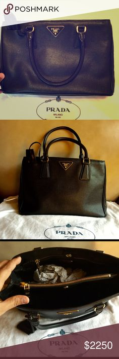 Prada lux tote Sold out in black! Prada Lux tote in EUC. Sleek and full on style!!! Comes with the original duster. Gold hardware. 13Wx9Hx6W. Retails for 2595$. Very selective trades. 100% authentic. Price negotiable! Prada Bags Satchels