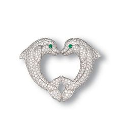 DIAMOND AND EMERALD DOLPHIN CLIP BROOCH, BY CARTIER Of heart-shaped ...