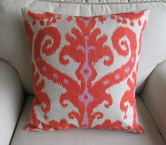 like this pillow and this etsy seller.  lots of great patterns and sizes....
