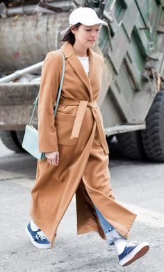 Street Style - all of the must-see winter outfits from NYFW 2015 -  ankle length camel coat + cuffed denim, a white baseball cap + sneakers