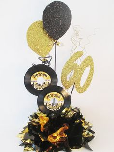 HEAD TABLE This centerpiece includes: a metallic tissue base 45 record with customized label 2 faux balloon cutouts Number is optional Disco Birthday Party, 70s Party, 70th Birthday Parties, Retro Party, Disco Party, Birthday Ideas, 60th Birthday Centerpieces, Birthday Party Decorations, Party Themes